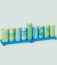 paper tubes, battery operated tea lights and base of precut wooden letters I