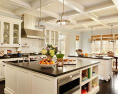 Love the large island, coffered ceiling and light fixtures. #kitchendesign www.HomeChannelTV.com