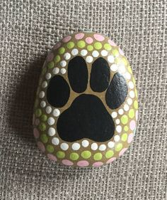 Painted Stone pet rock dog paw - Tap the pin for the most adorable pawtastic fur baby apparel! You'll love the dog clothes and cat clothes! <3