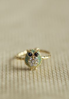 Twisted Owl Ring 11.99 at shopruche.com. Full of adorable detailing, this sweet owl ring features a twisted band and a turquoise colored belly dotted with sparkling rhinestones., Adjustable0.25