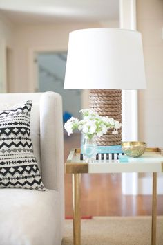 Add a nautical touch to your home: http://www.stylemepretty.com/living/2015/09/11/diy-rope-lamp/