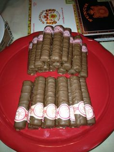 This is awesome idea! Who says you cant have cigars at your Cuban Party if you dont smoke LOL  Twix bars wrapped in cigar bands