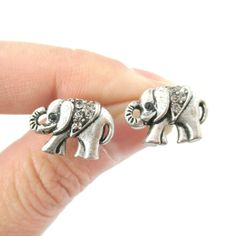 A pair of elephant shaped stud earrings in silver! Each one measures 1.5 cm wide by 1.1 cm tall and comes with earring backs.  ---  Material: Silver Plated Brass with Rhinestones  Handling time: Please allow two to three business days for us to process your order  SALE!!! Please visit o...