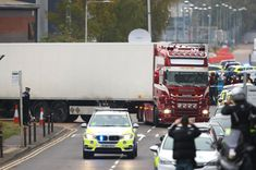 The driver of the truck, named locally as 25-year-old Mo Robinson, from Northern Ireland, remains in custody after he was held on suspicion of murder. Essex Police said on Friday that a man and a woman, both aged 38 and from Warrington, Cheshire, were arrested on suspicion of 39 counts of manslaughter and people trafficking. An international investigation is under way as post-mortem examinations are due to begin on the bodies found in a refrigerated trailer in Grays.