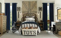 The Boy's Bedroom -A rugged industrial style of by-gone-years complimented with bleached wood & navy palette, a sturdy iron metal bed, a few industrial chic elements & lots of storage is an easy to keep tidy room. Cleverly conceived...love this!.