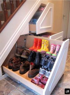 Genius, pull out shoe racks with wasted under stair space