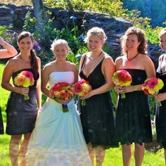 Black bridesmaid dresses with bright flower