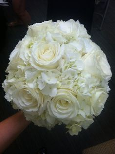 Love the shape and that the bouquet is made with Hydrangea and roses