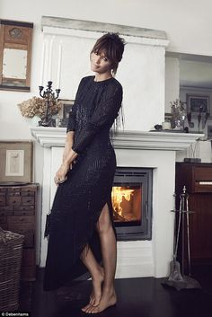 Looking flawless by her fireplace in this Butterfly by Matthew Williamson dress: £199...