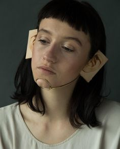 akiko shinzato, ear piece made from gold plated brass and vegetable tanned leather