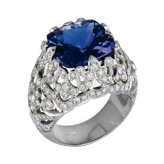 """Ring in white gold with diamonds and sapphire by Jack Kelège   Established in 1972 and headquartered in Los Angeles, California, Jack Kelége employs the finest jewelers to be found anywhere in the world, all of which he hand-picked and mentored for an average of twenty years. """"All of my artisans have the same strict standards of perfection that I have,"""" Jack Kelége explains. """"I am fortunate to have a staff made up of such remarkable talent. They take enormous pride in their life's work."""" The…"""
