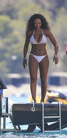 8dfbeab6dd12a Mel B shows off her impressive toned curves in white lace bikini as