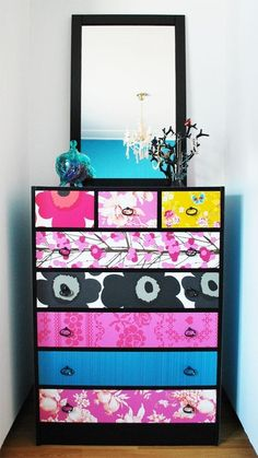 You can take a cheap dresser from a thrift store and make it yours with fabric or wrapping paper! Great for cheap college dorm room furniture.