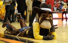 "University of Wyoming Cowboys. Pistol Pete. The nickname Cowboys was used as early as 1891 when a true cowboy assisted the Wyoming football team against a team from Cheyenne, Wyoming. One of the Cheyenne players allegedly yelled ""Hey, look at that cowboy,"" and the name stuck. Pistol Pete, the costumed character, attends games with live pony Cowboy Joe."