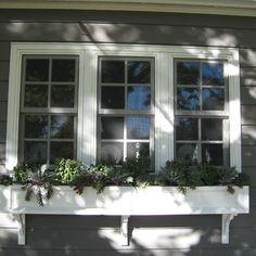 Trim around windows and second dark trim (matching bronze the window) around the outside.