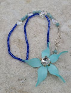 Light Blue Acrylic Flower Necklace by BabaJewelryandBeads on Etsy