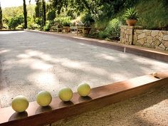 This Bocce court in Ross, California, was designed by David Brewer and features a traditional oyster shell surface.