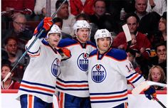 Jeff Petry #2 of the Edmonton Oilers celebrates his third period goal with teammates Ladislav Smid #5 and Jordan Eberle #14 during the NHL g...