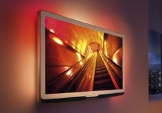 Ambilight: lighting around three sides of the set, capable of displaying a range of hues from each panel. Works best against a white wall.
