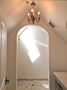 giannetti home: the french normandy house. Arched shower is a great design feature.