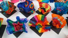 We looked at the work of glass artist Dale Chihuly for this project. Color a regular coffee filter in washable markers. Spray the.