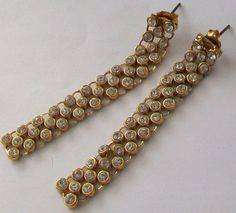 An elegant pair of dangle earrings with sparkling diamantes set in a gold tone weave Earposts for pierced ears Measurement approx 54 mm long x 6 mm Vintage Wedding Jewelry, Ear Piercings, Weave, Dangle Earrings, Dangles, Sparkle, Pairs, Jewellery, Elegant