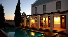 Peacefully located in the heart of the Cape Winelands, this Stellenbosch hotel is surrounded by vineyards and offers an outdoor swimming pool, a gym and an. Outdoor Swimming Pool, Swimming Pools, Country Hotel, Bedroom With Ensuite, South Africa, Hotels, Restaurant, Mansions, House Styles