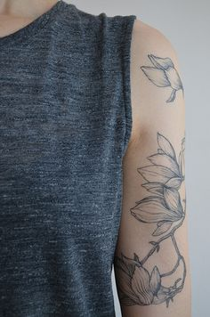 Brücius floral magnolia tattoo down front of arm