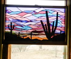 Saguaro Sunset - Large panel I made with various textured glass from a pattern I modified from a design in Southwest Designs II.  At night this is just as beautiful from outside as it is inside during the day.