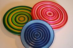 Coasters made with curling ribbon, coated in polyurethane, and backed in cork.  If the poly makes these as solid and sleek in person as in the picture this would be a neat project.