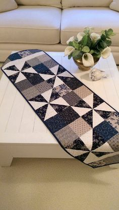 *New for January 2015*    This blue quilted table runner/wall hanging is just the thing for decoration this time of year. Made from quality