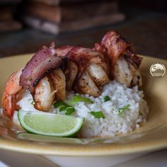 Surf 'n Turf action! We used our 5280 Pork® Smoked Bacon and wrapped  some @sizzlefishfit shrimp up in a bacon blanket and seasoned with @flavorgod Garlic Lovers on top of cilantro-lime rice. So delish! #bacon #shrimp #dinner