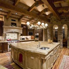 I love stone and wood in a kitchen but I would just a brighter color pallet.