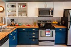 Navy lowers, white uppers + subway tile & butcher block countertops #kitchen