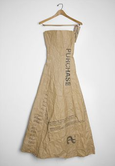 If you could source some of that 'paper bag' looking fabric and some industrial-looking stamps, this would be an awesome 'paper bag princess' Hallowe'en costume.