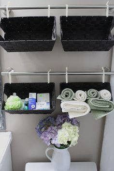 Simply DIY 2: A Tisket. A Tasket. A Wall Full of Baskets    When I saw this I thought about my diy baskets would those pair together perfect and save money! you could use this anywhere not just in the bathroom!