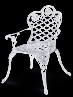 This white Victorian garden chair has and identical pattern as the table. the arms of the chair curve out just like the legs. Four of these chairs would be placed at the two large ends of the table in centre stage.