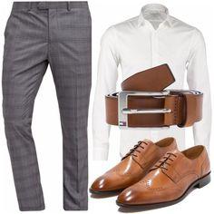 Per l'uomo sempre sicuro di se stesso camicia CK Calvin Klein colore bianco su pantaloni eleganti colore grey e scarpe stringate coordinate alla cintura di gusto classico color marrone.