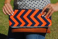 Neon chevron fold-over clutch by FloatingChairs