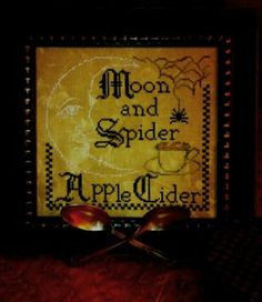 """""""Moon & Spider, Apple Cider"""" is this title of this cross stitch pattern from Needlework Workpress."""