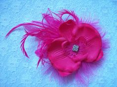 Cerise Fuchsia Pink Orchid Feather Brooch Corsage  by IndigoDaisyWeddings, £6.50 Order Now from www.indigodaisyweddings.co.uk Specialising in stunning bespoke cocktail fascinators and formal hats in a wide range of colours, perfect for Royal Ascot and The Kentucky Derby. Plus all your wedding floral accessories including shoe clips, vintage flapper bands, feather and flower fascinators, feather fans, fairy wands, wrist corsages, wedding bouquets & buttonholes. Worldwide Delivery.