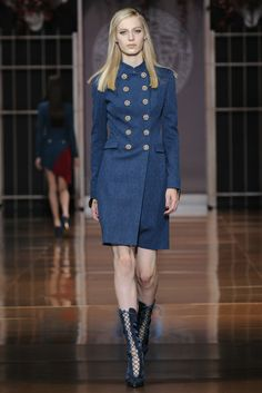Double-breasted, Military-style coat dress from Versace is classic with a touch of sassy.  This style works well for women who want to minimize a larger bust.  The hemline falls just above the knee and appropriate for the office.  Boots or pumps equally fabulous. #women #fall2014 #versace #dresses #wwd