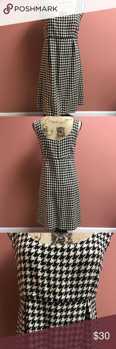 Vineyard Vines B&W Houndstooth Sleeveless Dress Versatile Vineyard Vines dress that can be worn with or without a shirt. Houndstooth fabric is 65% wool, 35% viscose; Pink whale lining around the bodice is 100% silk; remaining lining is 100% acetate. Dress has been dry cleaned and ready to wear; dry cleaning tag was removed so that I could photo the label. Vineyard Vines Dresses