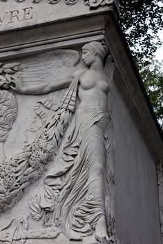 Nude angels protecting the tomb of the admiral | Cimetiere du Pere Lachaise, Paris - France