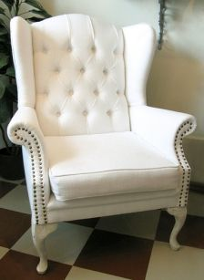 white armchair. love the shape, would look great in lime green or pink!