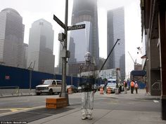 Invisible Man (look closely)    Chinese artist Liu Bolin, painted from head-to-toe, stands suitably camouflaged in front of Freedom Tower, where the Twin Towers once stood, in New York. Hiding In New York, his latest exhibition, has just opened at the Eli Klein Gallery in the city.