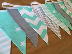 GORGEOUS MODERN MINT AND GREY BUNTING..... A lovely bunting using modern and very on trend mint green and grey fabrics , perfect for your babys nursery. Double sided fabric so can hang in more places. Ideal for either baby boy or girl as neutral colours. Also amazing for a