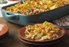 Chicken Taco Casserole. Yum! And very easy. Used rotisserie chicken. Try with hint of lime tostidos next time (10 oz bag was about 6c)