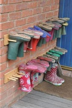 Ingenious Ways To Store Your Shoes Boot storage ideas (for back deck / porch) We'll need this for sure!Boot storage ideas (for back deck / porch) We'll need this for sure! Mud Boots, Rain Boots, Snow Boots, Welly Boots, Winter Boots, Boot Storage, Outdoor Shoe Storage, Shoe Storage Ideas For Garage, Diy Storage