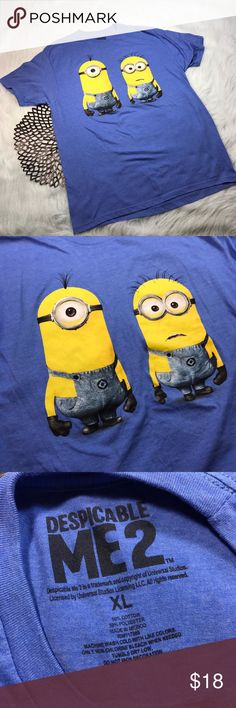 Despicable Me 2 Blue Minions Short Sleeve T-Shirt Despicable Me 2 Blue Minions Short Sleeve T-Shirt. Size XL. Made of 50% cotton & 50% polyester. Pre-owned, but in excellent used condition. No holes, stains or pilling. Measurements: Underarm to underarm is 22 inches. Length is 32 inches. Minions Tops Tees - Short Sleeve
